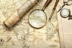 Vintage map. With retro objects and magnifier Royalty Free Stock Photography