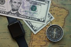 Vintage map of South America with five dolor bills, watch and a compass, close-up stock photos