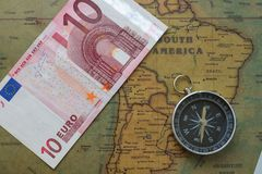 Vintage map of South America with ten euro and a compass, close-up royalty free stock image