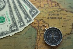 Vintage map of South America with two dolor bills and a compass, close-up royalty free stock photos