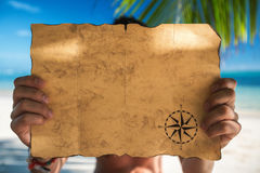 Vintage map and tropical island, travel concept. Vintage map and beautiful tropical island, travel concept Royalty Free Stock Photo