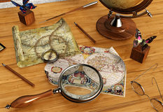 Vintage maps and magnifying glass on wood table Stock Photography