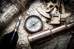 Vintage marine still life. Vintage still life with compass,sextant and old map royalty free stock images