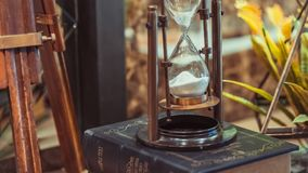 Vintage Maritime Brass Hourglass With Compass royalty free stock photography