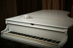 Vintage mask is on a white piano. royalty free stock photo