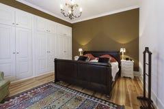 Vintage master bedroom with wooden floor Stock Photos