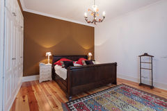 Vintage master bedroom with wooden floor Royalty Free Stock Photos