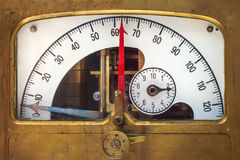 Vintage measurement instrument with a red needle indicator Royalty Free Stock Image