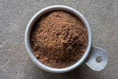 Allspice. A vintage measuring cup of allspice Royalty Free Stock Photography
