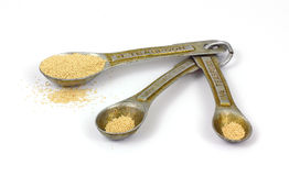 Vintage Measuring Spoons and Yeast Stock Image