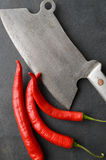 Vintage meat cleaver with chili pepper Royalty Free Stock Photography