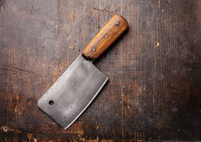 Vintage Meat cleaver. On dark wooden background stock images