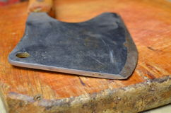Vintage Meat cleaver. On light wooden background stock photography