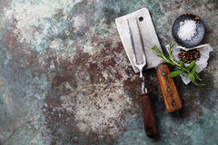 Vintage meat Fork and Cleaver with seasonings Stock Photo