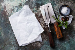 Vintage meat Fork and Cleaver with seasonings Stock Image