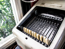 Vintage Mechanical Calculator. Next to the window Stock Photography