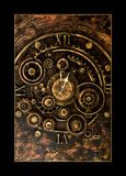 Vintage mechanical clock parts on vintage background. Vintage old mechanical clock parts on vintage abstract background texture royalty free stock photos