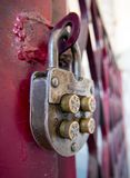 Vintage mechanical combination lock hanging on doors Stock Image