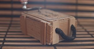 Vintage mechanical music box on a little wooden plank. stock video