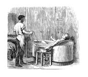 Vintage medical engraving, electric bath Royalty Free Stock Images
