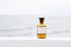 Vintage medicine bottle on sea background Royalty Free Stock Image