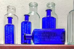 Vintage medicine bottles at Farmacia Francesa of Cuba -2. Old French Colonial pharmacy, Botica La Francesa, was founded by Dr Ernesto Triolet in 1882 and is kept Stock Photo
