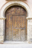 Vintage, medieval door Spanish city of Segovia. Old wooden entra. Nce. ancient architecture Stock Photography