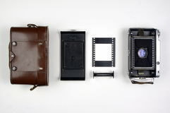 Vintage Medium Format Film Camera Components Organized on a White Background Stock Images