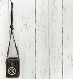 Vintage medium format photo Camera on the wooden batten wall Stock Photography