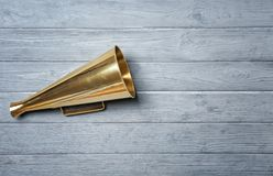 Vintage megaphone on background. Vintage megaphone on wooden background royalty free stock images
