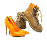 Vintage men boots and red platform high heels shoes Royalty Free Stock Image