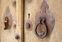 Vintage men's and women's door handles in Yazd, Iran. Stock Photos