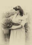 vintage Menina entre as plantas no jardim Imagem de Stock Royalty Free