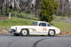 Vintage Mercedes Benz 300SL driving on country road. Adelaide, Australia - September 25, 2016: Vintage Mercedes Benz 300SL driving on country roads near the town Royalty Free Stock Photography