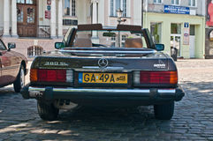 Vintage Mercedes 380 SL cabrio. Classic Polish beautiful Mercedes 380 SE cabrio during old cars race in Wejherowo, Poland. Yellow number plate informs that the Royalty Free Stock Images