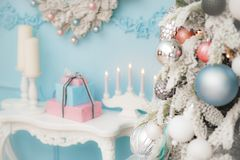 Merry christmas decor with fir tree with toys table with gift bo. Vintage merry christmas decor with fir tree with toys table with gift boxes and candles stock photography