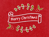 Vintage Merry Christmas ribbon banner in doodle style on craft p Stock Photo