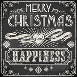 Vintage Merry Christmas Text on a Blackboard Stock Images