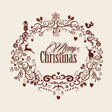 Vintage Merry Christmas text and mistletoe design. Retro Merry Christmas text inside mistletoe decoration composition. EPS10  file organized in layers for easy Royalty Free Stock Images