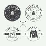 Vintage Merry Christmas or winter sales logo, emblem, badge. Label and watermark in retro style with sweaters, hats, scarfs, trees, stars, decor, deers and Royalty Free Stock Image