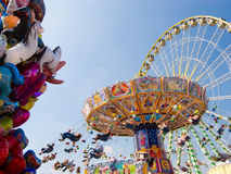 Vintage merry-go-round. And big wheel Stock Image