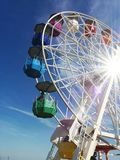 Vintage merry go round in Barcelona, Spain. Backlight and blue sky. royalty free stock photos