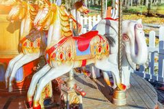 Vintage Merry-Go-Round flying horse carousel in amusement holliday park royalty free stock photography