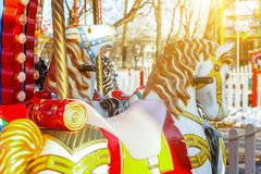 Vintage Merry-Go-Round flying horse carousel in amusement holliday park stock photography