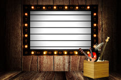 Vintage message board with light box and light bulb Royalty Free Stock Image