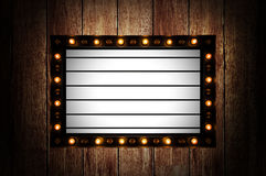 Vintage message board with light box and light bulb Royalty Free Stock Images