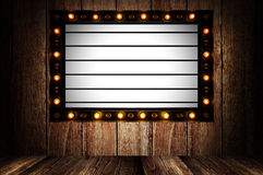 Vintage message board with light box and light bulb Stock Images