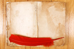 Vintage message book with red feather Stock Photography