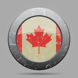 Vintage metal button with flag of Canada - grunge Royalty Free Stock Photo