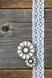 Vintage metal buttons flowers and lace ribbons Royalty Free Stock Image